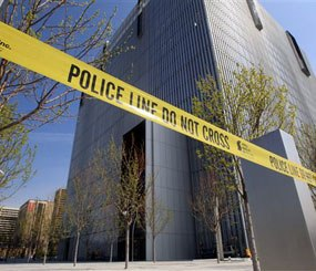 Police tape surrounds the Federal Courthouse Monday, April 21, 2014, in Salt Lake City. A U.S. marshal shot and critically wounded a defendant on Monday in a new federal courthouse after the man rushed the witness stand with a pen at his trial in Salt Lake City, authorities said. (AP Image)