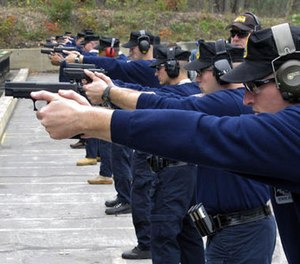 In this Oct. 24, 2012, file photo, Connecticut State Police recruits practice with their new .45-caliber Sig Sauer pistols during a
