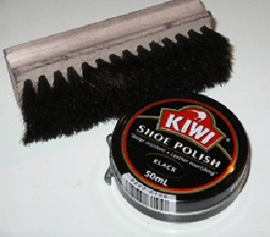 Shoe polish with a shoe brush. (Wikipedia Image)