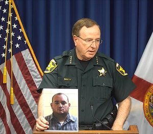 Sheriff Grady Judd holds a press conference about the arrest of former deputy Peter Heneen in Winter Haven, Fla.