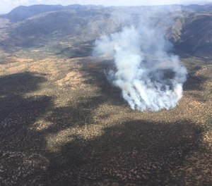 An aerial view of the Polles Fire in Arizona on July 4. Airwest Helicopters Pilot Bryan Boatman, 37, died in a helicopter crash while battling the blaze on Tuesday, July 7. (Photo/National Weather Service Western Region)