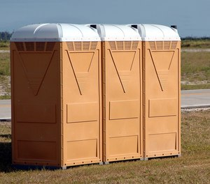 An engaged couple, an EMT and a nurse, helped save a man who had a seizure in a port-a-potty Wednesday.