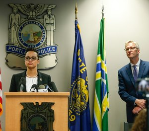 Portland Police Chief Danielle Outlaw and Mayor Ted Wheeler pictured in 2017.