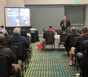 FireRescue1 Editorial Advisory Board Member Gary Ludwig uses PowerPoint during a presentation at a fire service conference.