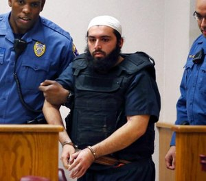 In this file photo from Tuesday, Dec. 20, 2016, Ahmad Khan Rahimi, the man accused of setting off bombs in New Jersey and New York in September is led into court in Elizabeth, N.J. (AP Photo/Mel Evans, File)