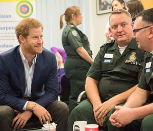 Prince Harry speaking with London Ambulance personnel.