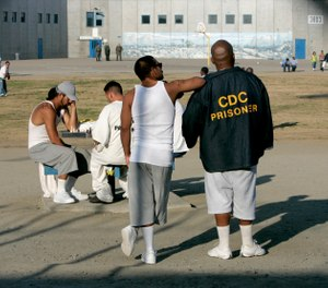 In this Jan. 14, 2009 file photo inmates use the recreation yard at Corcoran State Prison in Corcoran, Calif. (AP Photo/Rich Pedroncelli, File )