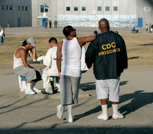 In this Jan. 14, 2009 file photo inmates use the recreation yard at Corcoran State Prison in Corcoran, Calif.