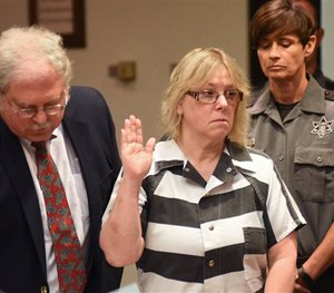 In this July 28, 2015 file photo, Joyce Mitchell raises her hand during a court appearance in Plattsburgh, N.Y. (AP Image)