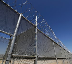 This Wednesday, Aug. 28, 2019, photo shows the Adelanto U.S. Immigration and Enforcement Processing Center operated by GEO Group, Inc. (GEO) a Florida-based company specializing in privatized corrections in Adelanto, Calif. (AP Photo/Chris Carlson)