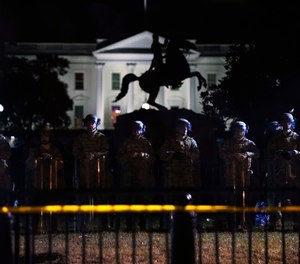 With the White House in the background, a line of police forms behind a fence in Lafayette Park as demonstrators gather to protest the death of George Floyd, Tuesday, June 2, 2020, in Washington. (Photo/AP)