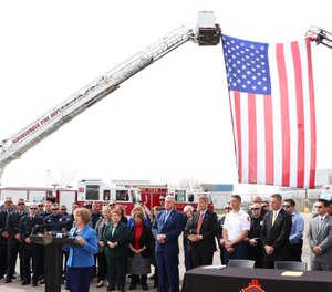 Gov. Michelle Lujan Grisham signed legislation Tuesday aimed at guaranteeing medical coverage for firefighters who endure post-traumatic stress disorder triggered by their work. (Photo/Governor's Twitter)