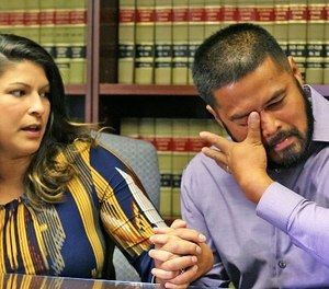 Sub.  Orlando Police Officer Gerry Realin, right, becomes emotional, wipes tears from his eyes as his wife Jessica shares her feelings during an interview Thursday, August 11, 2016 almost 2 months since the Pulse nightclub shooting massacre. (Red Huber/ Orlando Sentinel/TNS)