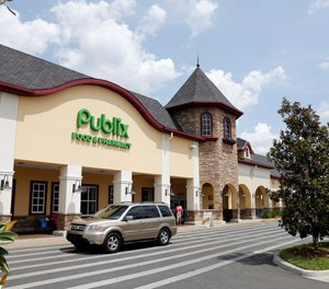 In this Sunday, May 19, 2013 file photo, a vehicle passes the front of the Publix supermarket in Zephyrhills, Fla. (AP Photo/Scott Iskowitz, File)