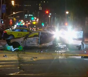 This Feb. 6, 2016 image provided by KPIX CBS 5 shows police and fire officials responding after a car crash that killed three on a San Francisco street. (KPIX CBS 5 via AP)