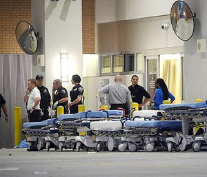 In this June 12, 2016, file photo,emergency personnel wait with stretchers at the emergency entrance to Orlando Regional Medical Center hospital for the arrival of patients from the scene of a fatal shooting at Pulse Orlando nightclub in Orlando, Fla.