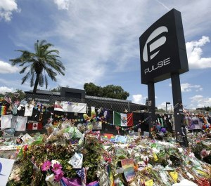 In this July 11, 2016, file photo, a makeshift memorial continues to grow outside the Pulse nightclub in Orlando, the day before the one month anniversary of a mass shooting, in Orlando, Fla. (Photo/TNS)