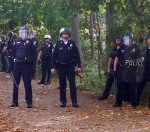 Local police, firefighters and ambulances in New Hampshire responded to large crowds of students as the annual Pumpkin Festival was underway near Keene State College Saturday, Oct. 18, 2014.
