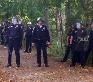 In this photo provided by Seth Meyer police officers line up. Local police, firefighters and ambulances in New Hampshire responded to large crowds of students as the annual Pumpkin Festival is underway near Keene State College Saturday, Oct. 18, 2014. (AP Image)