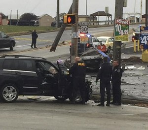 Police investigate the scene of a multi-vehicle crash at the intersection of Route 30 and Route 48, Thursday, Nov. 24, 2016, in North Versailles, Pa.
