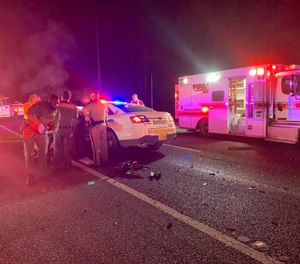 Medics respond to the scene of a crash between two sheriff's deputies Tuesday night in Putnam County, Florida.