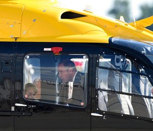 Great Britain's Prince William looks at the interior of a Airbus helicopter with his son Prince George. (Christophe Gateau/dpa via AP)