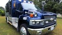 Design show host turns retired ambulance into camper