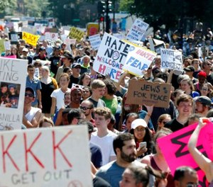 """Counterprotesters stand on the periphery of a """"Free Speech"""" rally staged by conservative activists on Boston Common, Saturday, Aug. 19, 2017, in Boston. (AP Photo/Michael Dwyer)"""
