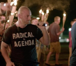 In this Friday, Aug. 11, 2017, file image made from a video provided by Vice News Tonight, Christopher Cantwell attends a white nationalist rally in Charlottesville, Va.