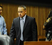 Testimony resumes in Detroit cop's trial for deadly raid