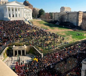 Thousands of gun-rights activists leave the Capitol grounds after a rally protesting gun-control legislation ended peacefully Monday, Jan. 20, 2020, in Richmond, Va. (Photo/Steve Helber/AP)