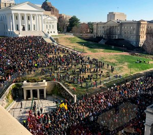 Thousands of gun-rights activists leave the Capitol grounds after a rally protesting gun-control legislation ended peacefully Monday, Jan. 20, 2020, in Richmond, Va.