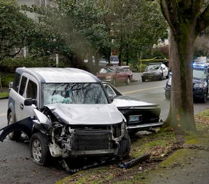 A wrecked vehicle is seen after a driver struck and injured at least five people over a 20-block stretch of Southeast Portland, Ore., before crashing and fleeing on Monday, Jan. 25, 2021, according to witnesses. (Beth Nakamura/The Oregonian via AP)