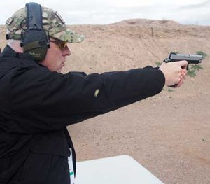 P1 Editor in Chief Doug Wyllie shoots the Springfield Armory 1911 Range Officer in forged stainless steel at SHOT Show 2016. (PoliceOne Image)