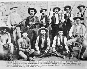 In this photo of Texas Rangers, Company D, John Hughes is seated in a chair at the far right. (Photo/Public Domain)