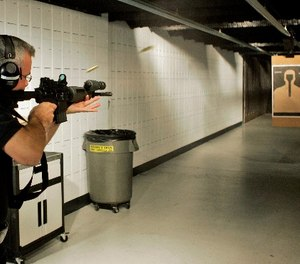 Milwaukee Police range master Sgt. James MacGillis fires an M4 rifle at the range Wednesday, Aug. 15, 2007, in Milwaukee. (AP Photo/Morry Gash)