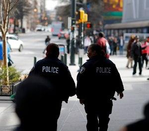 Police patrol near Mercedes-Benz Stadium ahead of Sunday's NFL Super Bowl 53 football game between the Los Angeles Rams and New England Patriots in Atlanta, Friday, Feb. 1, 2019. (AP Photo/David Goldman)