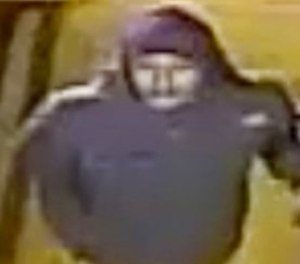 This image taken from a Feb. 24, 2015 surveillance video and provided on Feb. 17, 2018 by the New York City Police Department, shows a man being sought by the NYPD in connection with a rape three years ago.