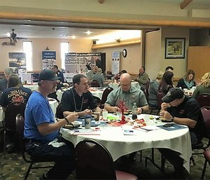 South Dakota Ambulance Association attendees, paid and volunteer, work together on action plans for recruitment, public relations and leadership using SWOT analysis. (Photo/Nancy Magee)