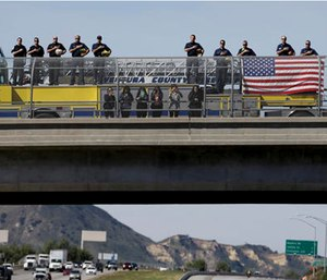 Ventura County firefighters salute as the hearse carrying the body of Nancy Reagan makes its way to the Ronald Reagan Presidential Library. (AP Photo/Jae C. Hong, Pool)