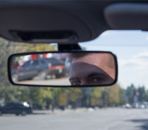 When driving home, you should be alert and aware. Look in your rearview mirror and make note of the vehicles you're seeing. (Photo/Pixabay)