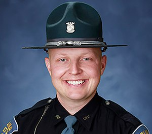 Indiana State Trooper Ben Reason used the Heimlich maneuver to save a 5-year-old boy who began choking as his family was returning from vacation. (Photo/Indiana State Police via AP)