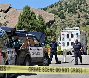 Police guard the south entrance to Red Rocks Amphitheater, in Morrison, Colo., Friday June 20, 2014. (AP Image)
