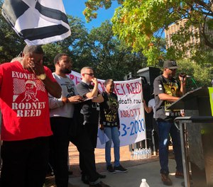 Edward Moore wipes his eyes while Rodrick Reed, brother of death row inmate Rodney Reed, rallies supporters outside the Texas governor's mansion in Austin, Texas. (Photo/AP)
