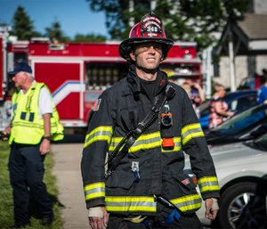 Heat-related illness is serious business, and firefighters are particularly at risk when temperatures hit the 90s and humidity hovers around 80 percent. (Photo/Joe Thomas of Greenbox Photography)