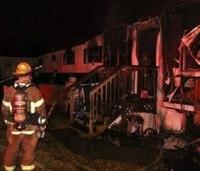 Firefighter saves 2 kids from burning trailer