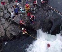 Firefighters rescue man from base of raging waterfall
