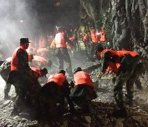 Rescuers work at a tourist site in Zhangzha in Jiuzhaigou county in southwestern China's Sichuan province. (Zheng Lei/Xinhua via AP)