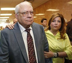 Robert Bates, left, leaves his arraignment with his daughter, Leslie McCreary, right, in Tulsa, Okla., Tuesday, April 21, 2015.