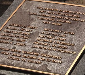 The names of the first Black firefighters in Virginia are memorialized on a plaque.